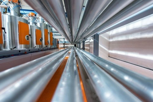 Rows of chrome pipes subject to heavy corrosion in geothermal energy production.