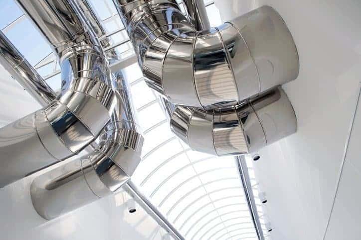 Silver chrome air ducts that follow ASHRAE standards.