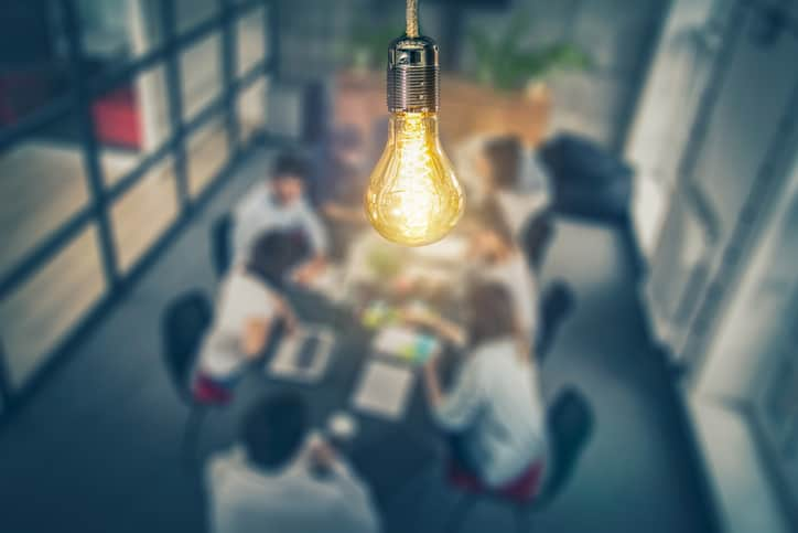 Lightbulb above the ISO 56007 working group as they develop the international standard for innovation management.