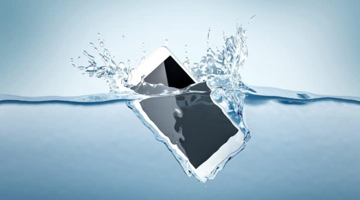 A smartphone plummets into the water and is destroyed due to a low IP Code rating under IEC 60529.