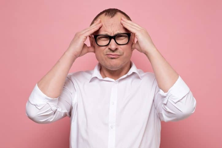 Customer upset on pink background and ready to complain about an ISO/IEC 17025 accredited laboratory.
