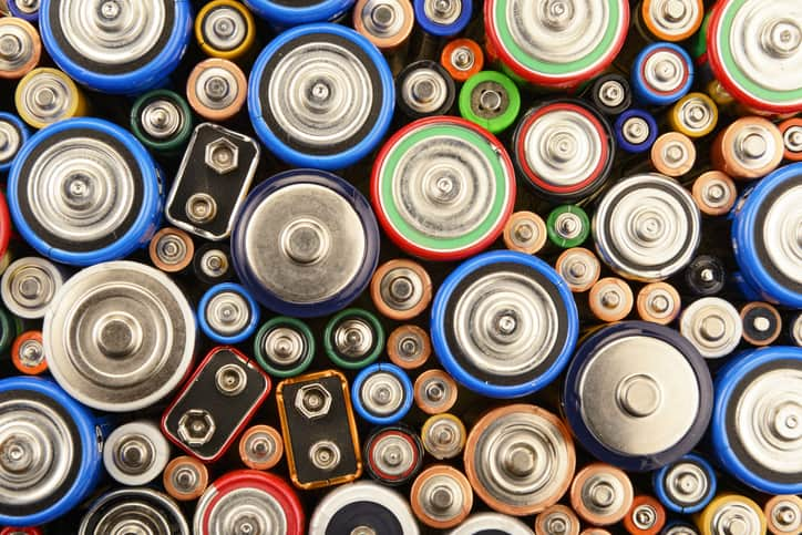 Bright colorful batteries that are being carefully recycled for sustainability purposes.