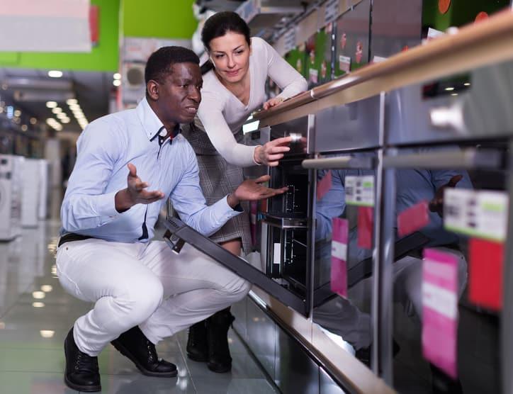 Woman shopping for EPA Energy Star chrome oven assured environmentally friendly through ISO/IEC 17025 ANAB accreditation.