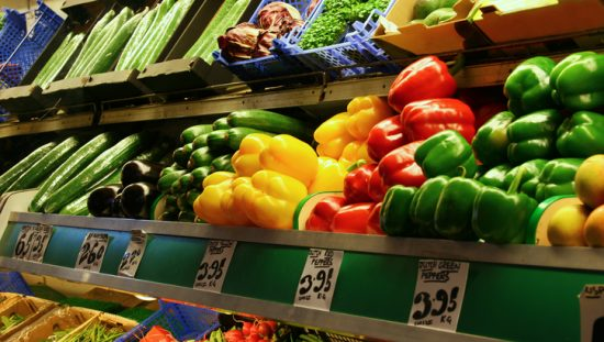 Vibrant colorful peppers in produce line with safety assured through FSSC 22000 food safety management accreditation.