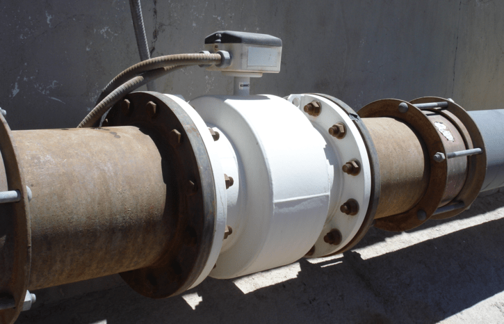 A rusty magnetic inductive flowmeter (magmeter) installed in accordance with AWWA C751-2019.