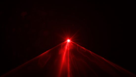 Red laser emitting through amplified darkness in ANSI Z136.1-2014 safe use.