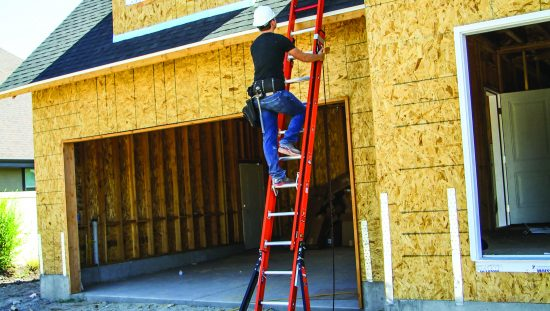 Construction worker climbing red metal extension ladder with three points of contact and basic safety tips.