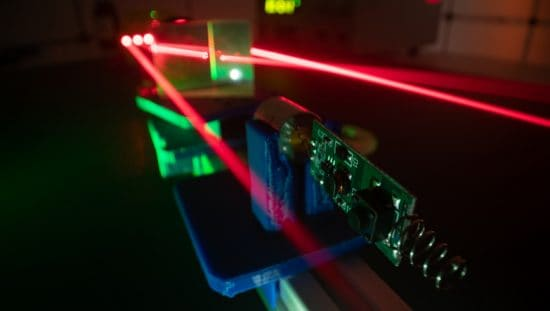 Red lasers amplifying through ANSI Z136.8-2021 approved research, testing, and development for safe use.