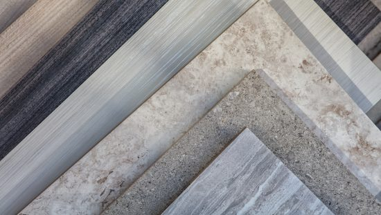 Stacked gray ceramic tiles following ASTM and referenced in ANSI A137.1